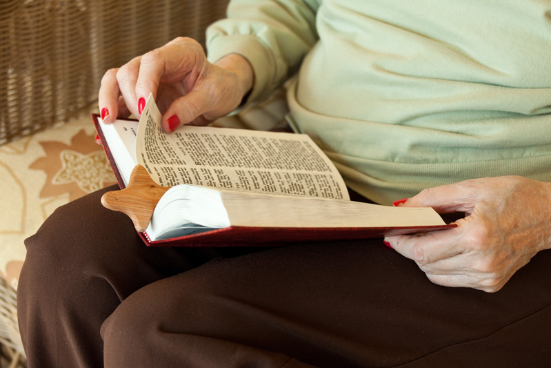 Auburn Homes resident reading Bible