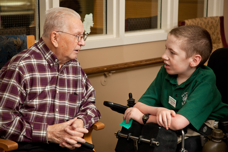 boy volunteer chatting with a resident