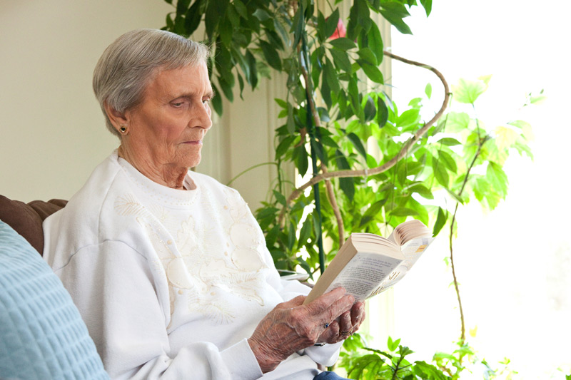 Auburn Courts assisted living resident reading