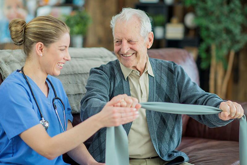 Physical therapist working with an Auburn Manor resident